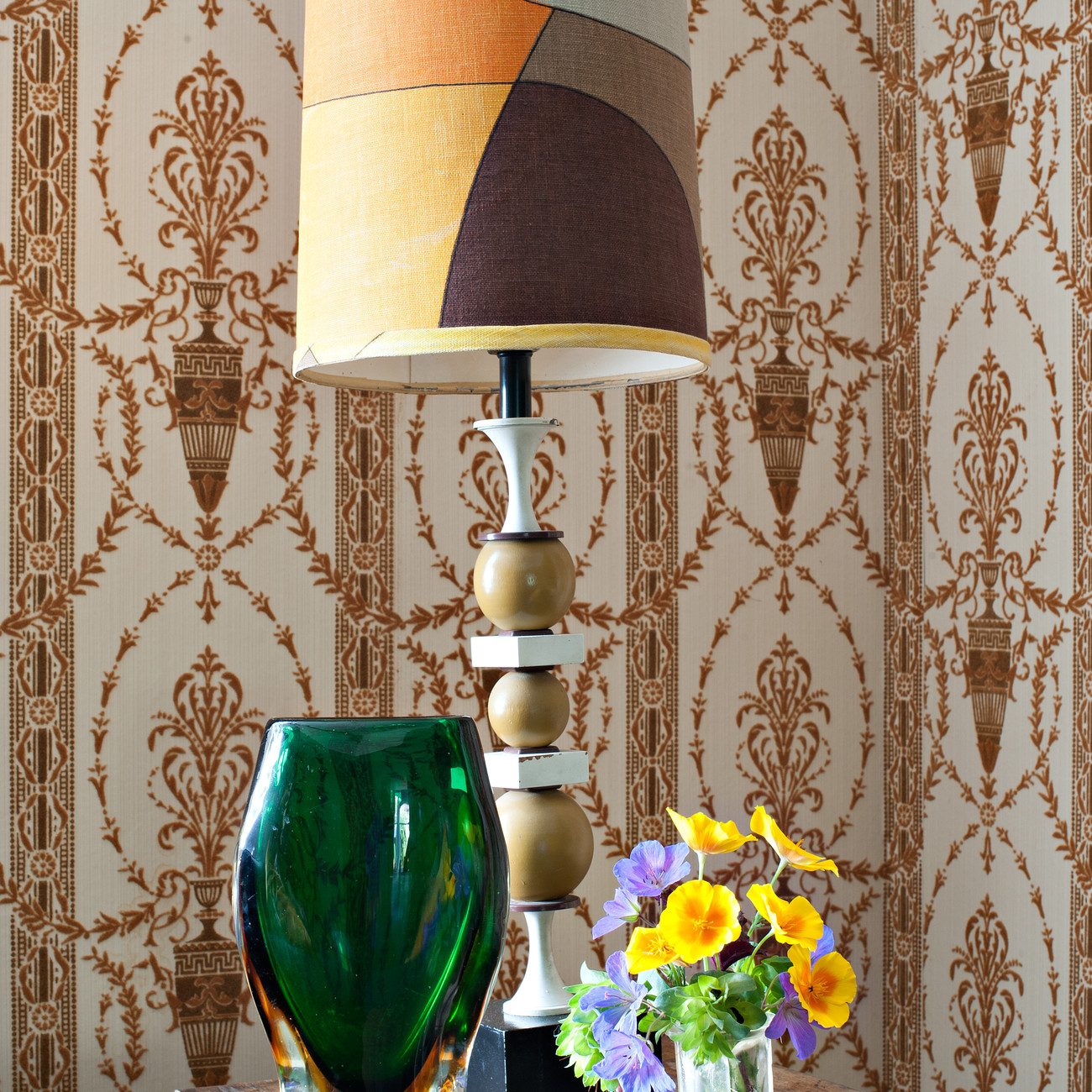table with lamp and flowers